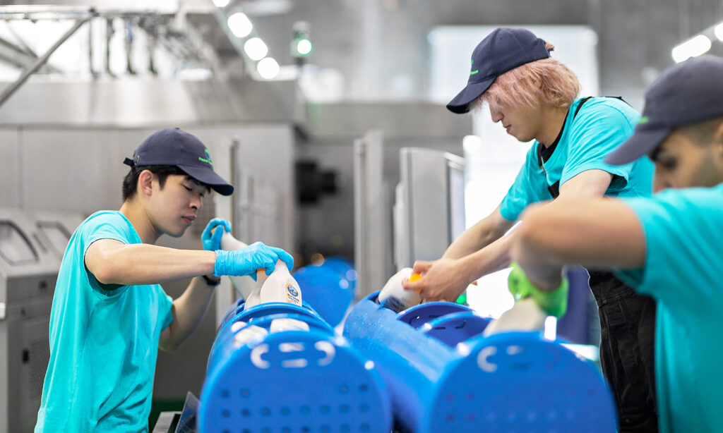 HPP Canada employees loading containers with juices